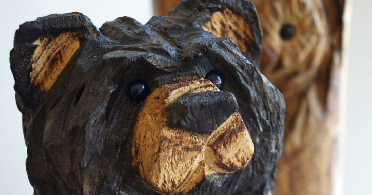 a wood carving of a bear