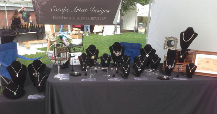 a booth set up with jewelry