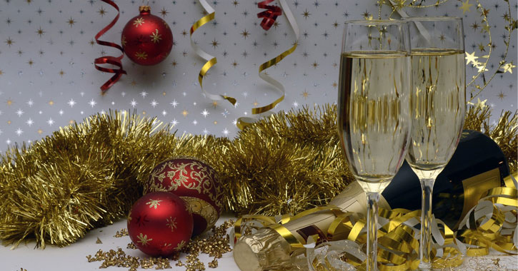 stock photo of two champagne glasses and gold and red decorations