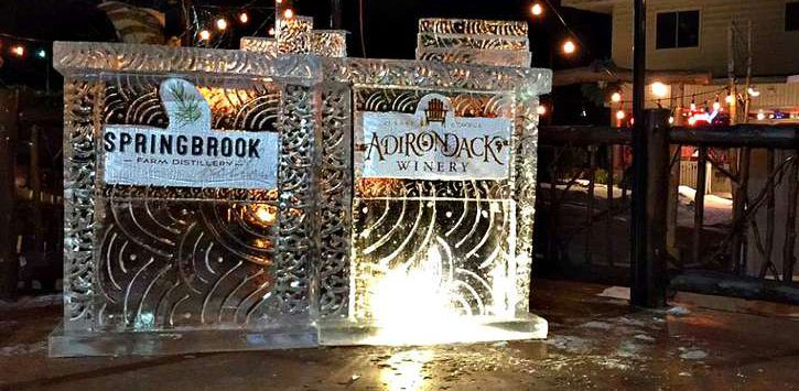 ice sculpture with signs of Springbrook Farm Distillery and Adirondack Winery