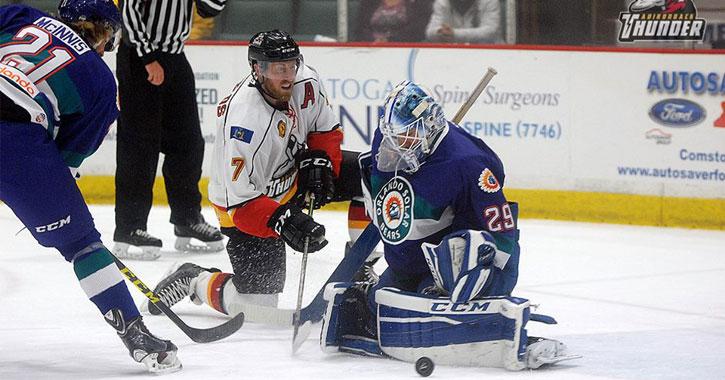 three Adirondack Thunder hockey players mid-game