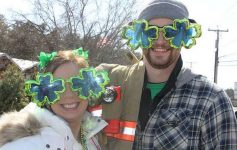 a couple with large clover sunglasses posing