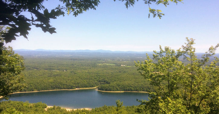 a view of a lake from a summit