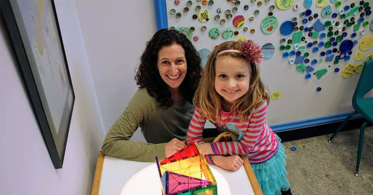 a mother and daughter in a children's museum