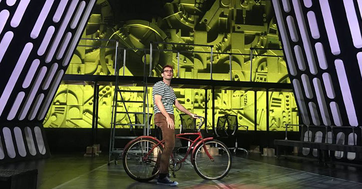 a guy on a bike on stage