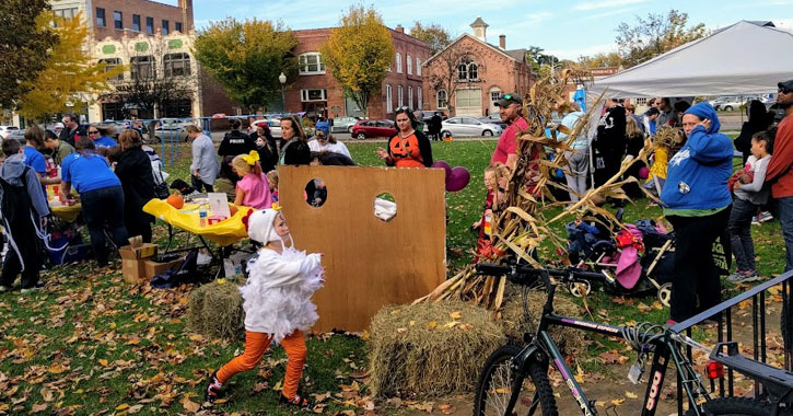 kids in costumes for Halloween outside