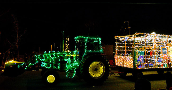 a tractor in a parade lit up