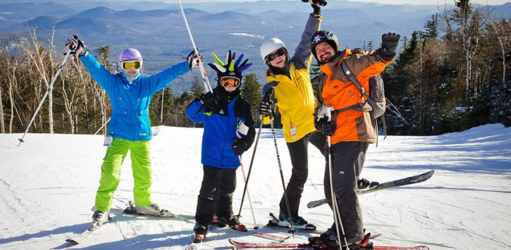 four people on a ski peak