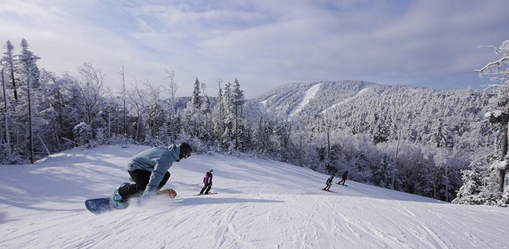 snowboarding going down mountain