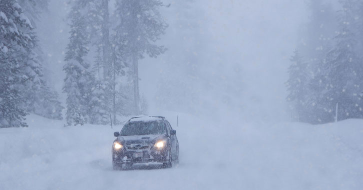 car in heavy snow