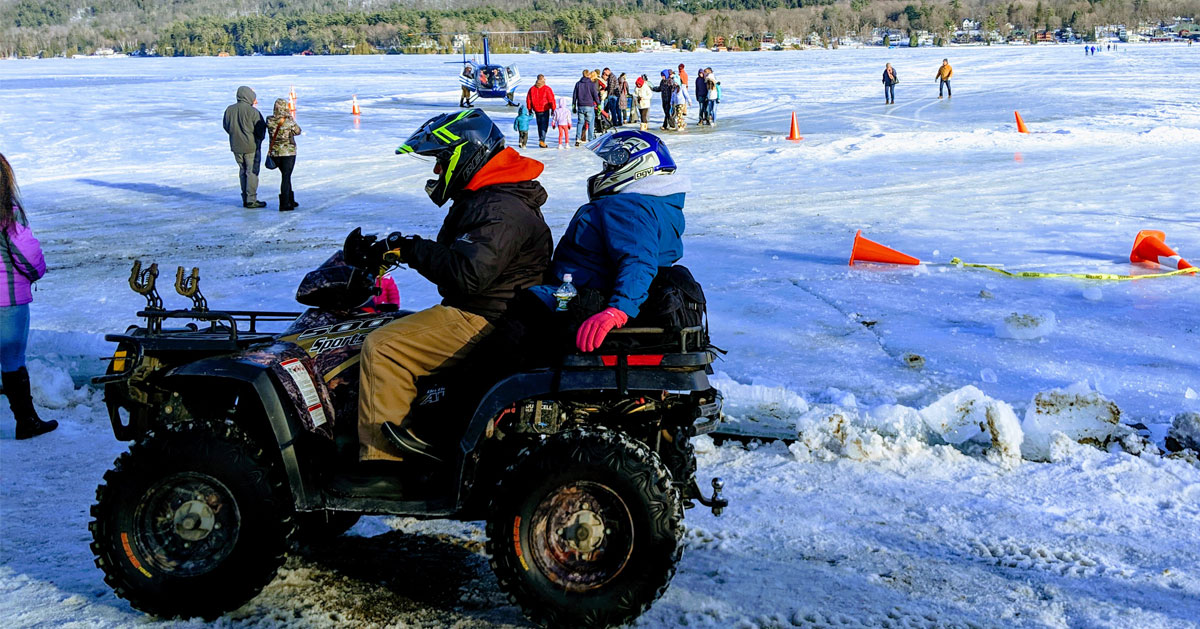people on an ATV, other people on ice