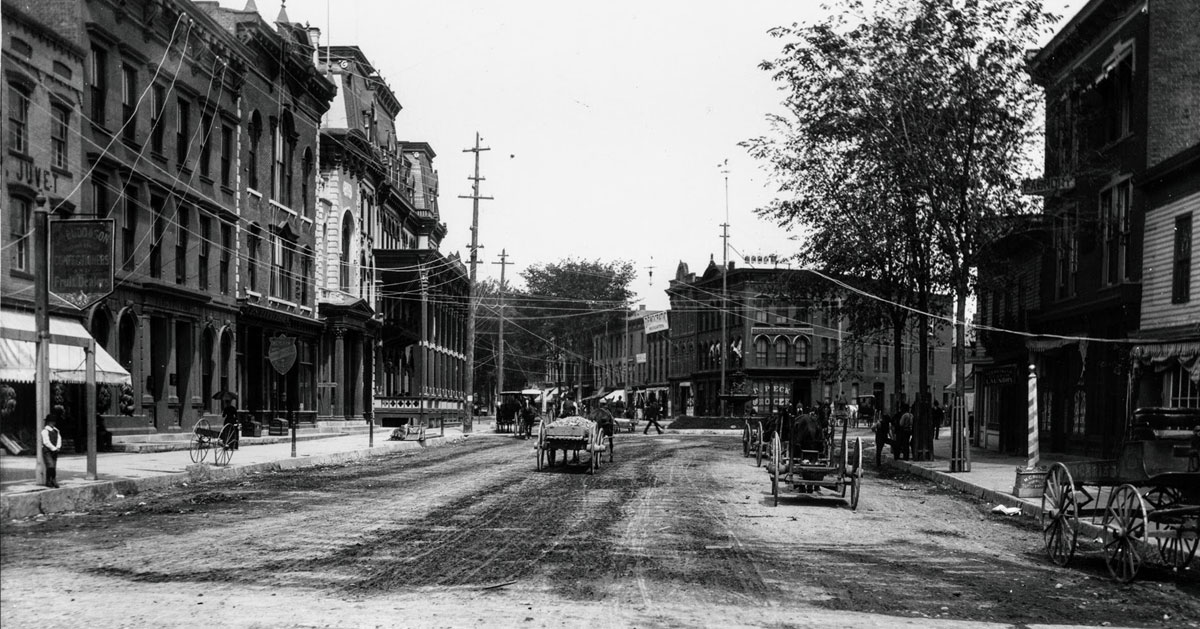 black and white historical image of street