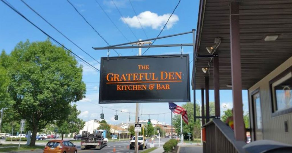 sign outside grateful den restaurant