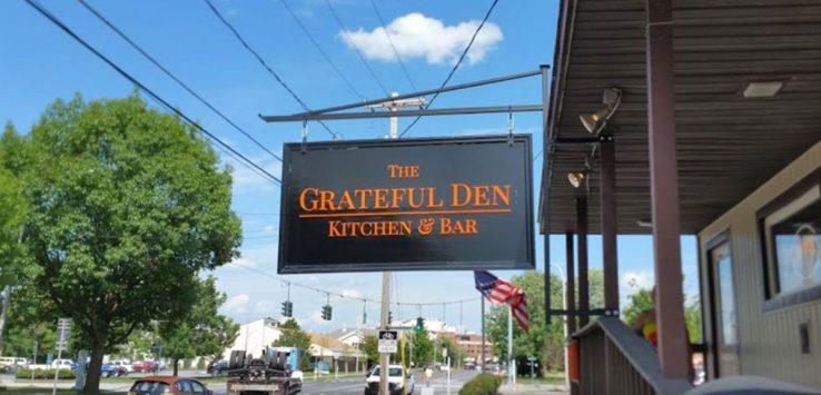 sign outside grateful den restaurant