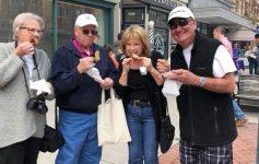 four people eating wings