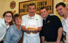 New Way Lunch employees around 100th anniversary cake