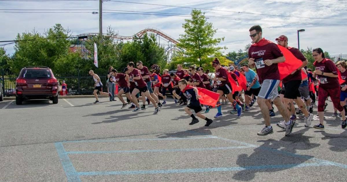 people in superhero costumes running