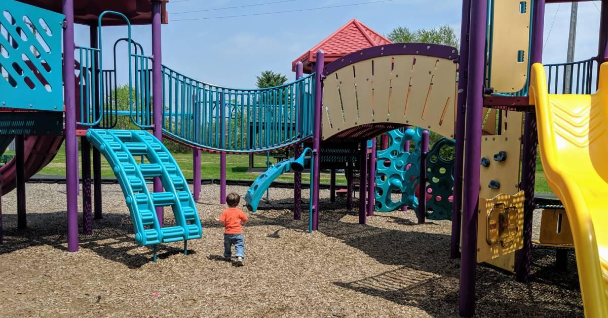 toddler runs on playground
