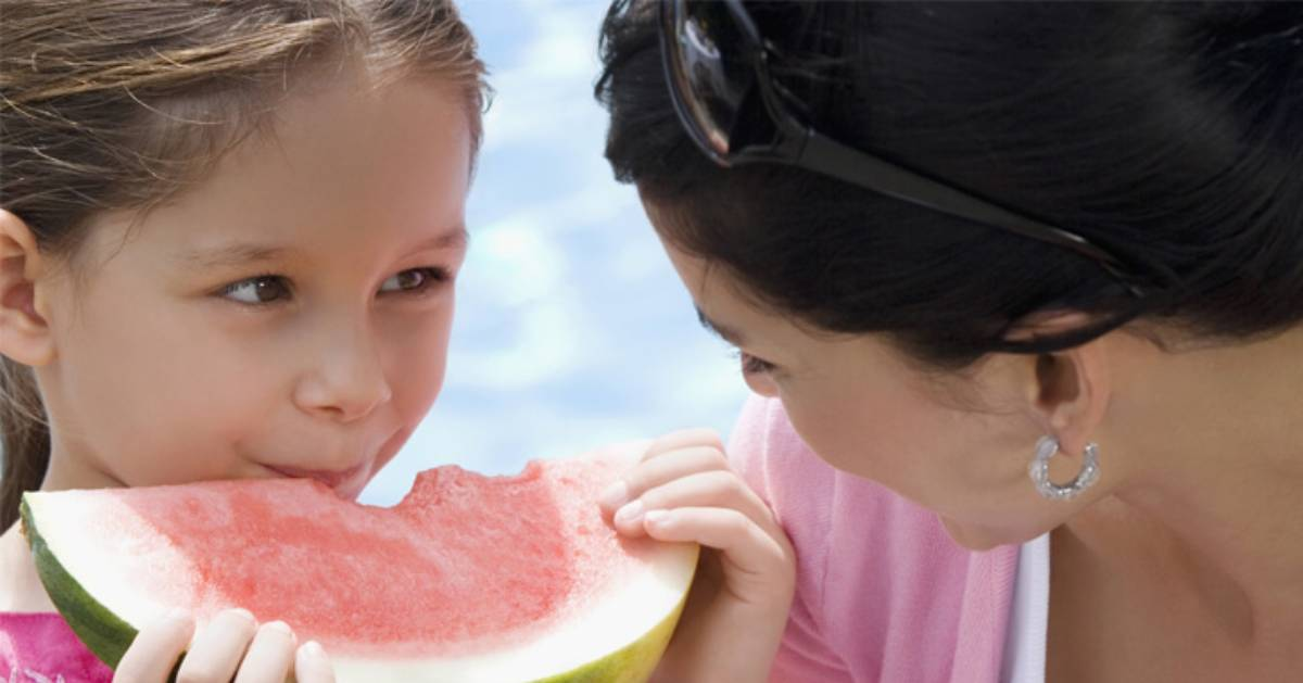 girl eating a watermelon