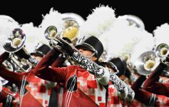 members of a marching band playing horns