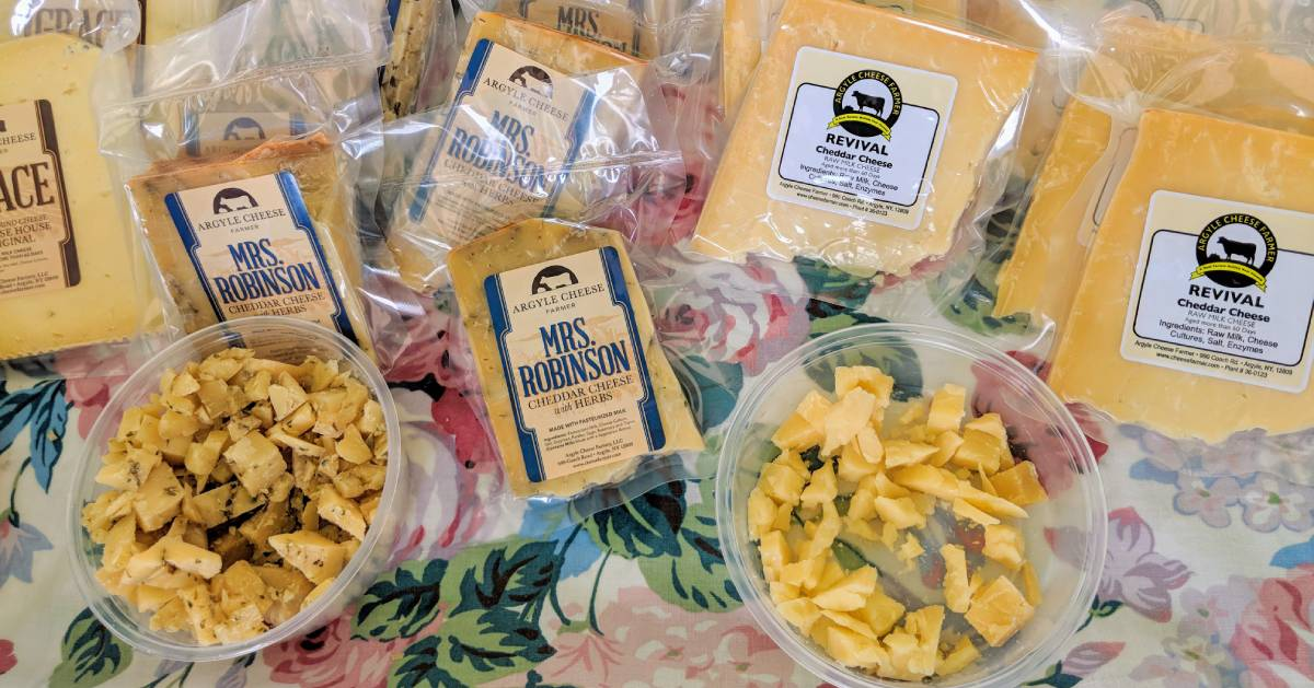 cheese and cheese samples on table