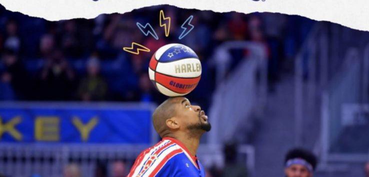 globetrotter balancing a basketball on his head