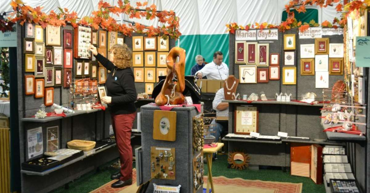 a vendor booth with jewelry at the larac fall arts festival