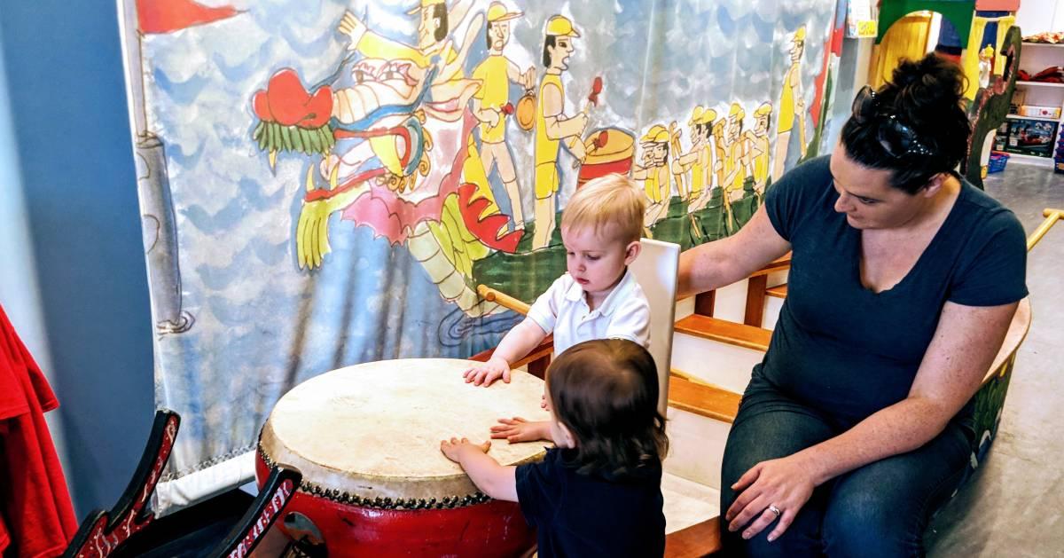 kids playing drum in kids museum