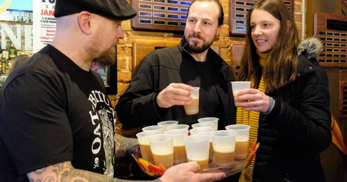people taking beer samples