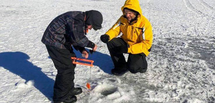 two people ice fishing