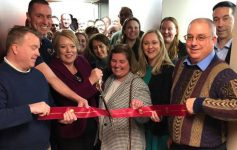 group of people at a ribbon cutting