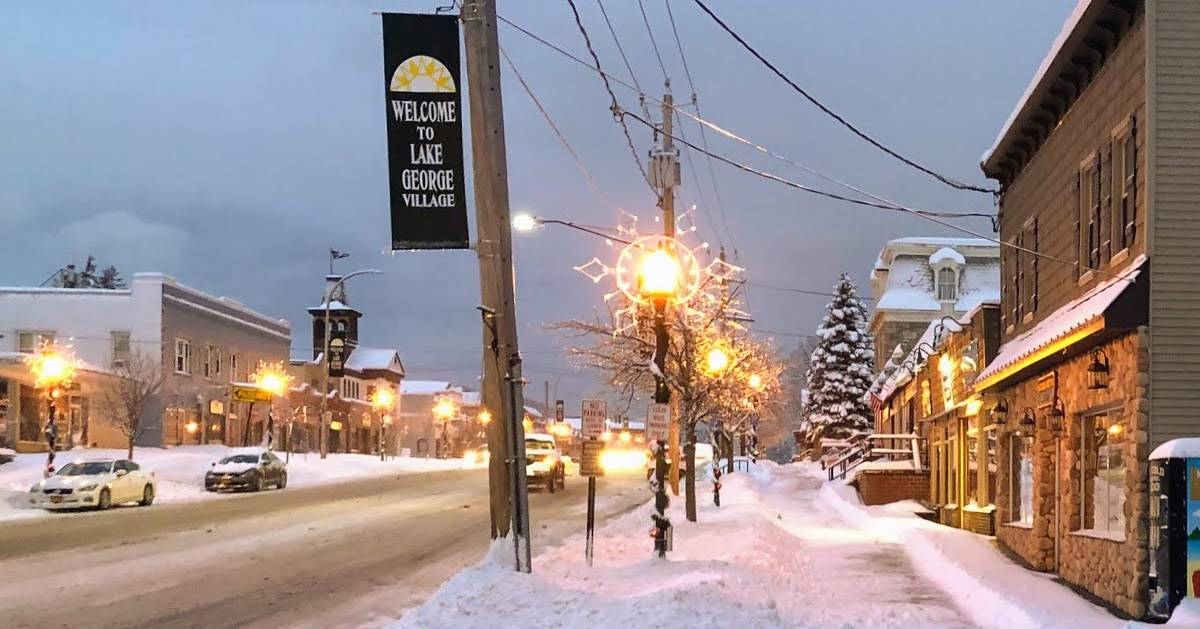 street and Lake George Village sign in winter