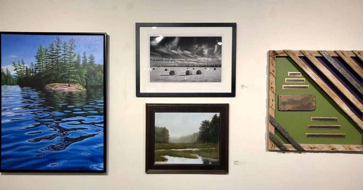 four pieces of artwork on the wall