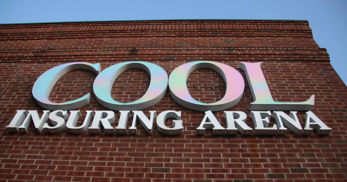Cool Insuring Arena sign on building