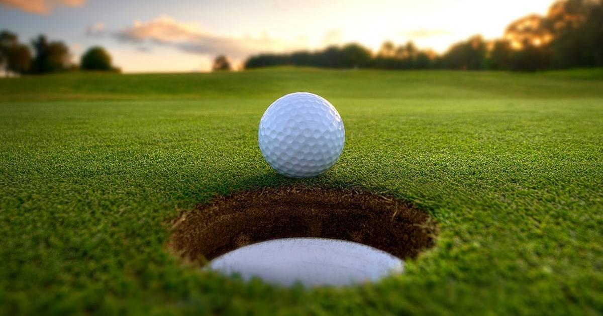 golf ball going towards hole