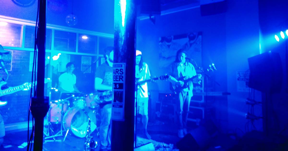 band performs in blue light