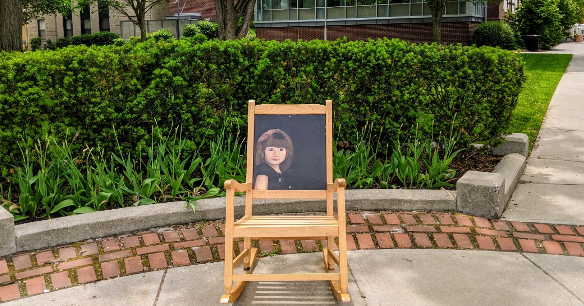 painting of girl on a chair in park